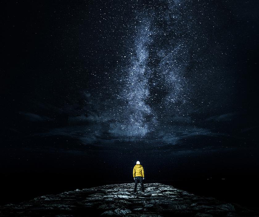 man standing under night sky