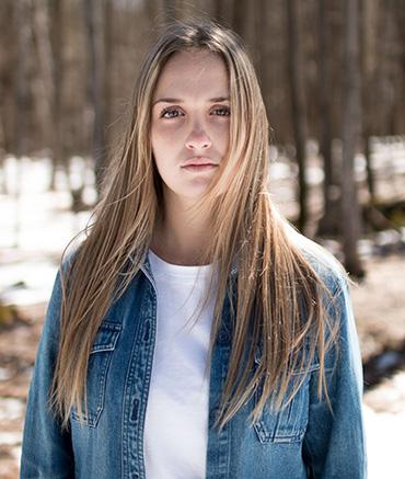 woman posing in woods
