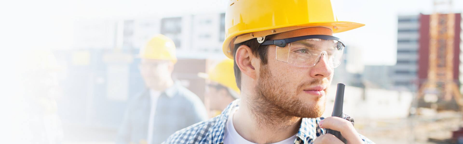 man in hard hat and safety glasses